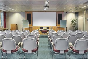Meeting room with chairs and a projector