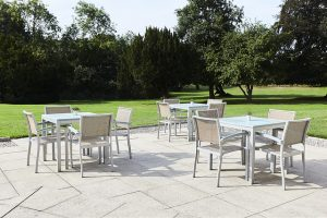 Patio area outside with tables and chairs